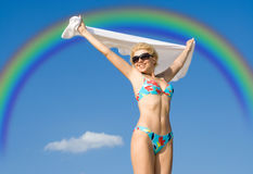 Flight over rainbow. Happy girl relaxing on the beach Royalty Free Stock Photography