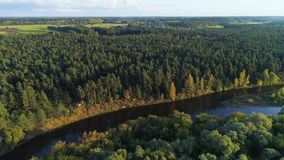 Flight over river and forest stock video footage