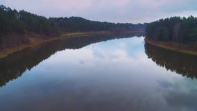 Flight over river loops stock video