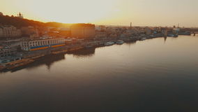 Flight over a river port in a European city at sunset aerial. Flight over a river port in a European city at sunset 4K UHD aerial stock footage
