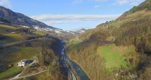 Flight over a river valley in the alps, aerial view from the mountain in summer Austria stock footage