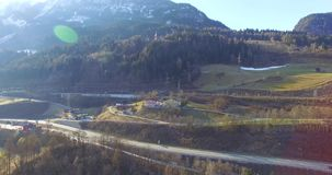 Flight over a river valley in the alps, aerial view from the mountain in summer Austria stock video footage