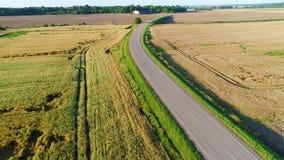 Flight over road in summer field. S stock video