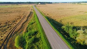 Flight over road in summer field. S stock video footage
