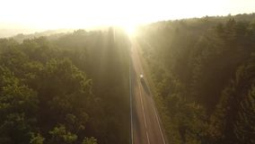 Flight over the road at sunrise