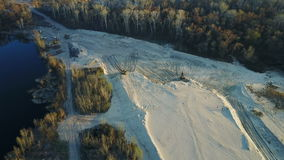 Flight over the sand mining company stock footage