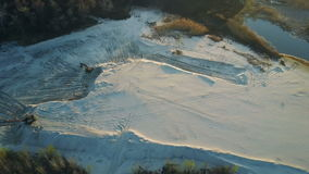 Flight over the sand mining company stock video footage