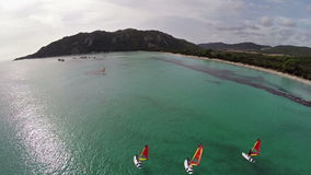 Flight over sea bay with surfers in France, Corsica, Santa Giulia beach. Aerial view. stock video footage