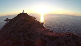 Flight over the sea and islands with lighthouse at sunset, Ajaccio area, Corsica, France. Aerial view. stock video