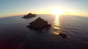 Flight over the sea and islands at sunset, Ajaccio area, Corsica, France. Aerial view. stock video
