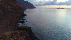 Flight over a seashore at sunrise stock footage