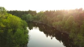 Flight over the Seim River, Ukraine surrounded by trees - aerial videotaping. Flight over the Seim River Ukraine, surrounded by trees - aerial view stock video