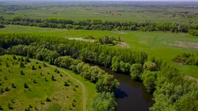Flight over the Seim River, Ukraine surrounded by trees - aerial videotaping stock video footage