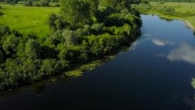 Flight over the Seim River, Ukraine surrounded by trees - aerial videotaping stock footage