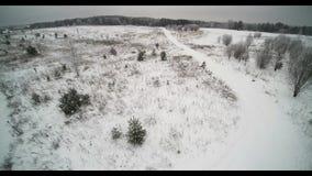 Flight over snowy fields stock video