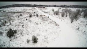 Flight over snowy fields stock video footage