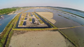 Flight over soline in Slovenia, place of sea salt extraction, aerial view. stock video footage