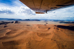 Sossusvlei orange dunes seen from plane. View out of a plane over the Sossusvlei Desert in Namibia, Africa Royalty Free Stock Photo