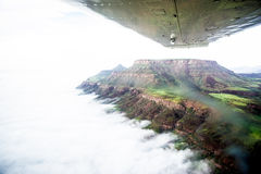 Flight over the table mountains of Namibia on foggy day royalty free stock photography