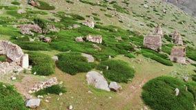 Flight over medieval tombs near Eltyulbyu, Kabardino-Balkaria, Russia stock video footage