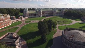 Flight over Tsaritsino palace in Moscow. Queen Ekaterina residence. Park garden architecture. Aerial view. From above Drone 4k stock video footage