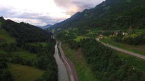 Flight over a valley in the alps stock video footage