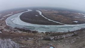 Flight over the winter river in the village stock footage