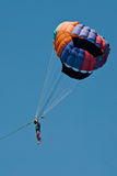 Flight parachute behind boat Royalty Free Stock Images