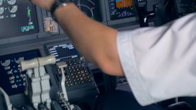 Flight parameters` setting process held by the pilot in a cockpit. 4K stock footage