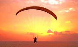 Flight of paraplane. Above Mediterranean sea on sunset Stock Photo