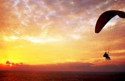 Flight of paraplane above Mediterranean sea Stock Photography