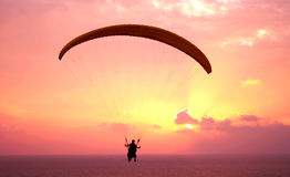 Flight of paraplane above Mediterranean sea. On sunset Royalty Free Stock Photos