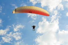 Flight on a paraplane. The person soars on a paraplane in the sky Royalty Free Stock Images