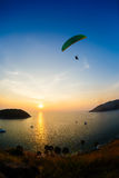 Flight of a paraplane in the twilight Stock Photo
