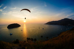 Flight of a paraplane in the twilight Stock Photos