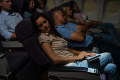 Flight passengers sleep plane cabin night travel Royalty Free Stock Photo