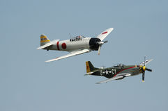 Flight from the Past. Flyby of Japanese Zero and American P-51 Mustang Stock Image