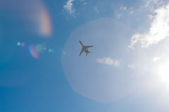 Flight. Pictured on the plane in flight against the blue sky and bright sun Stock Photos