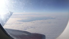 Flight by plane over clouds