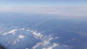Flight by plane over mountains