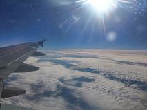 Flight by plane, sky, clouds, sun Stock Images