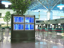 Flight schedule and check in counter Stock Image