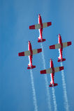Flight show. Four airplanes in red and white flying in the air at the flight show Stock Photo