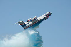 Flight with simulated fire extinguishing. Seaplane Be-200, Taganrog, Russia, May 17, 2014. Aviation plant, demonstration flights Stock Photos