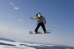 Flight in the sky. Flying snowboarder Royalty Free Stock Photography