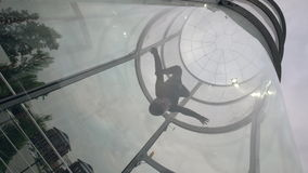 Flight skydiver in training wind tunnel. Flying in a wind tunnel. Indoor sky diving. Flight skydiver in training wind tunnel. Professional skydiver flies in wind stock video footage