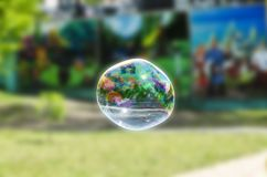 Flight of soap bubble in the park. They are up in the air stock photography