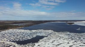 Flight on a spring day over the ice drift of the Nadym river in the North of Western Siberia. Flight on a spring day over the ice drift of the Nadym river in stock video footage