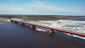 Flight on a spring day over the ice drift of the Nadym river in the North of Western Siberia. Flight on a spring day over the ice drift of the Nadym river in stock video