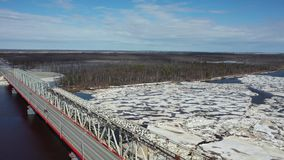 Flight on a spring day over the ice drift of the Nadym river in the North of Western Siberia. Flight on a spring day over the ice drift of the Nadym river in stock footage